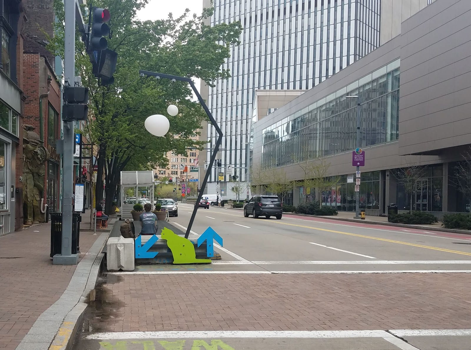 The curb extensions at a bus stop on Liberty Ave in Downtown serve multiple purposes: shortens the crossing distance for pedestrians, creates a sitting area, adds space for landscaping, makes it easier for a bus pull to the curb, and even adds a place to eat take-out