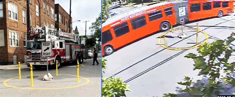 image shows a firetruck and an articulated port authority bus successfully navigating the traffic circle